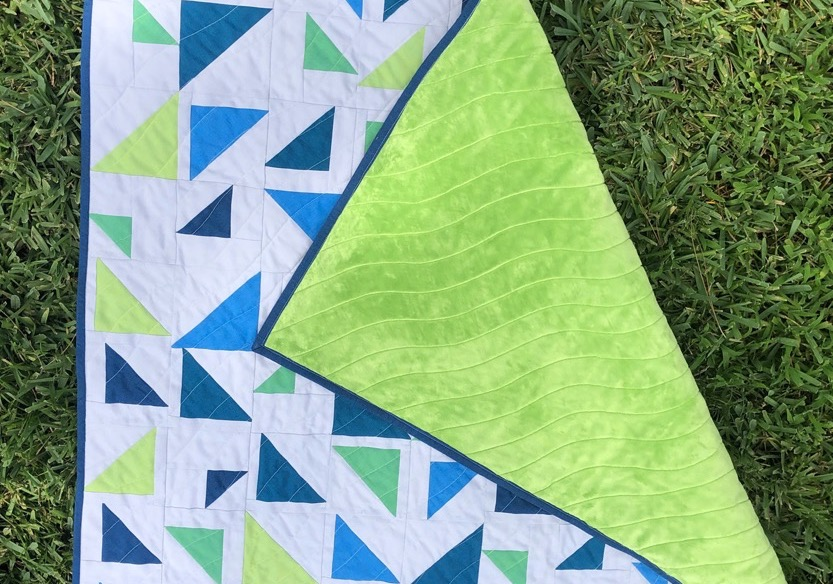 Baby quilt close up quilting wavy lines baby quilt sewing tutorial
