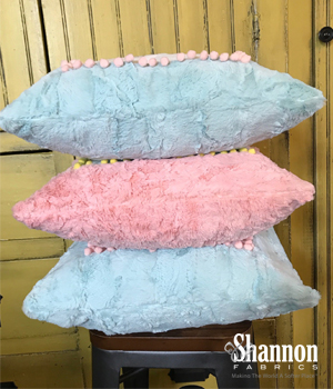 A pile of Luxe Cuddle pillows