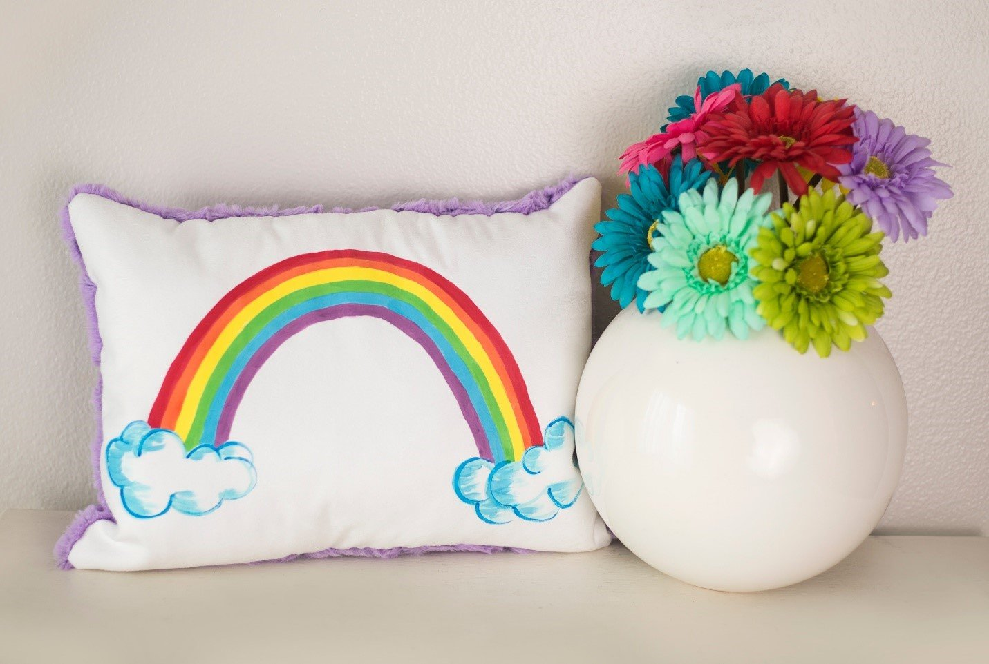 Rainbow Painted Pillow - from Pretty Painted Pillows DIY for Spring in Cuddle® Suede and Luxe Cuddle®