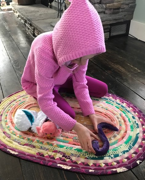 Rose playing with the Cuddle Hatchlings